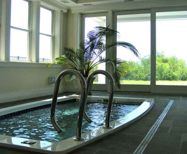 Indoor swimming lap pool in a home in Virginia Beach built by Covington Contracting
