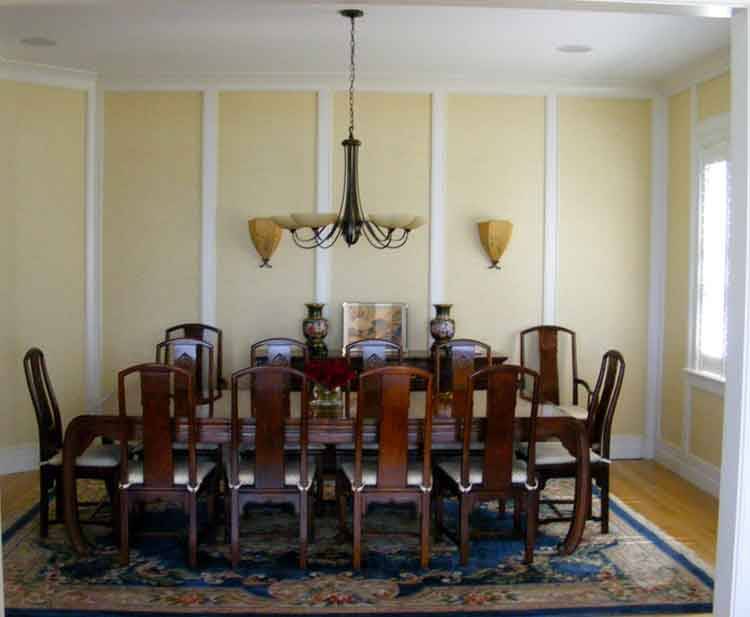 Dining room with a beautiful table and chairs in a home in Virginia Beach built by Covington Contracting