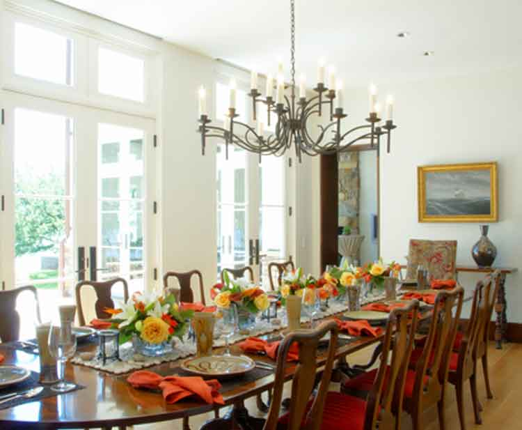 Dining room with a table set for dinner in a home in Norfolk Virginia built by Covington Contracting