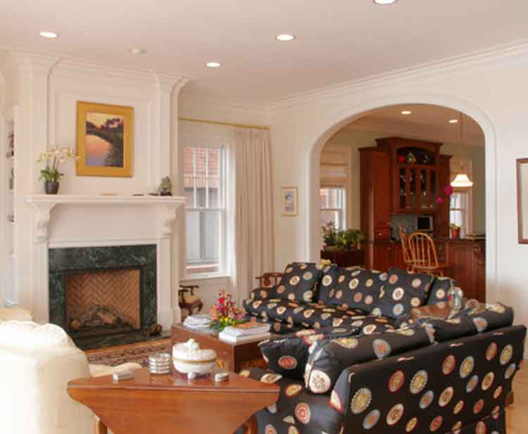 Living room with fireplace in a home in Norfolk Virginia by Covington Contracting