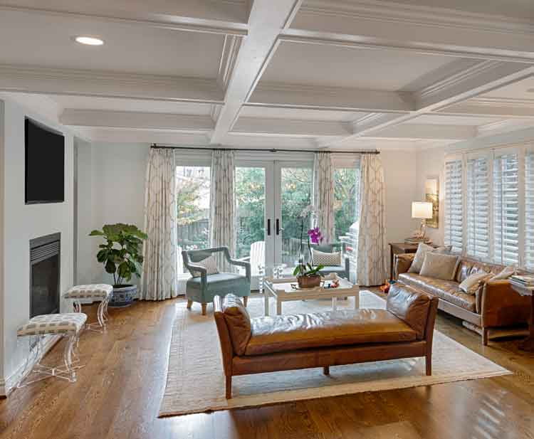 Living room remodel with a fireplace and french doors as a remodel
