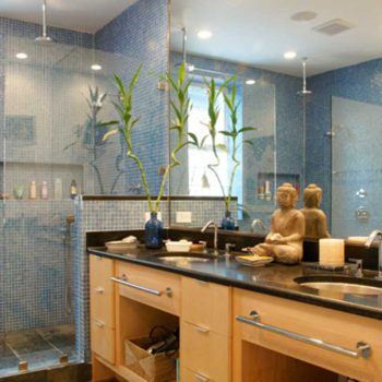 A Luxury Bathroom With Wood Cabinets And Stone Counter Tops