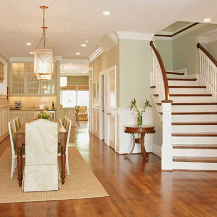 A Stunning Dining Room Featuring A Grand Staircase