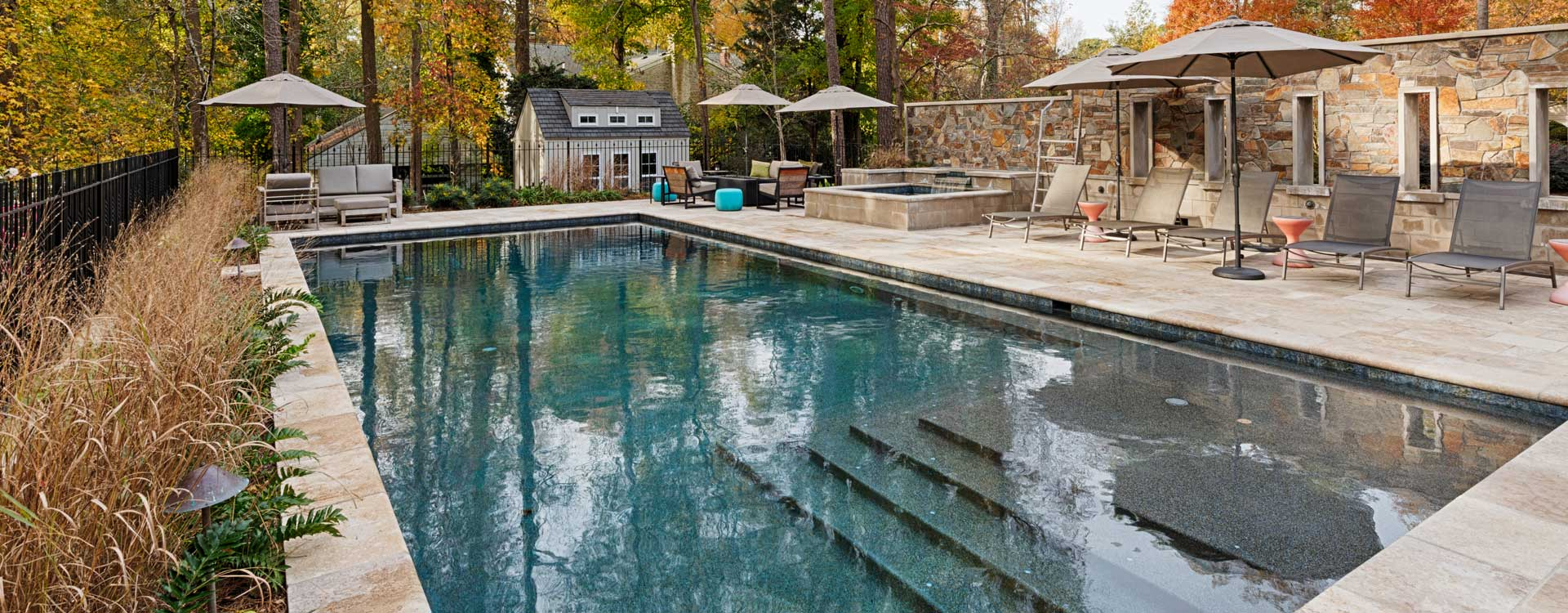 Pool Renovation With Blue Water And Outdoor Furniture Built By Covington Contracting Luxury Custom Homebuilder