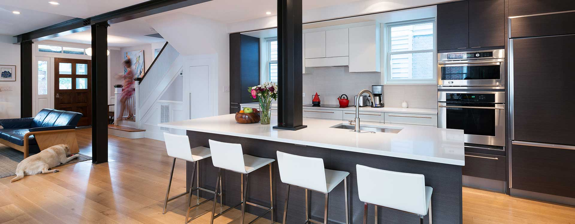 A Kitchen Renovation With Dark Cabinets And White Stone Counter Tops Built By Covington Contracting Luxury Custom Homebuilder In Hampton Roads Virginia