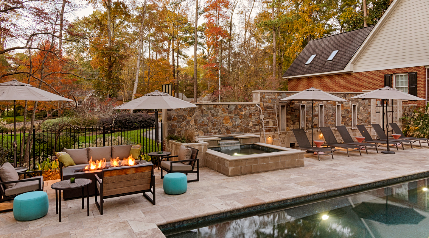 Beautiful fall picture of a pool, fireplace and hot tub renovation