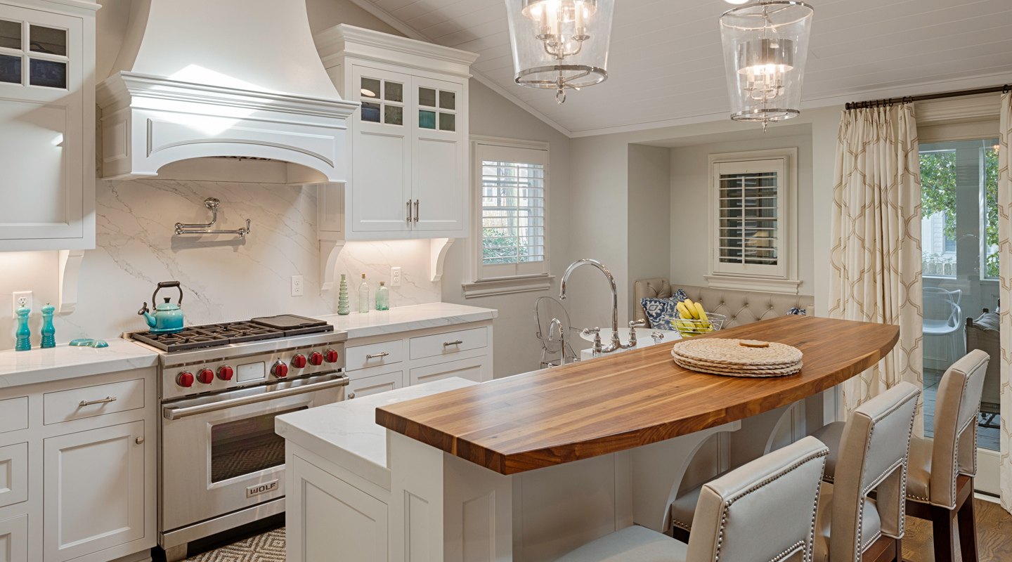 A beautiful white kitchen with a wood and stone counter top showing a remodeling job by Covington Contracting