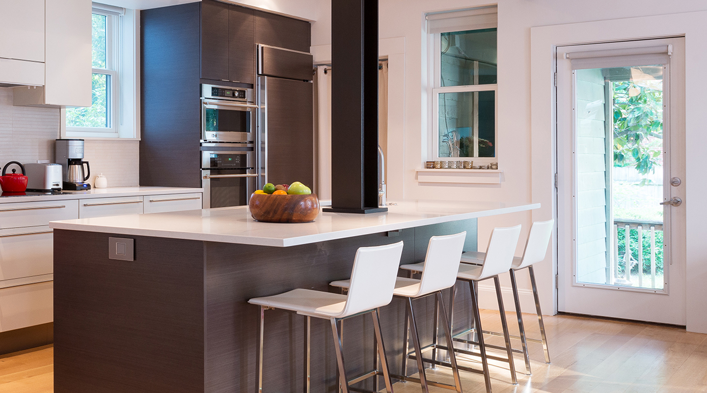Covington Contracting's About Us page featuring a beautiful modern kitchen